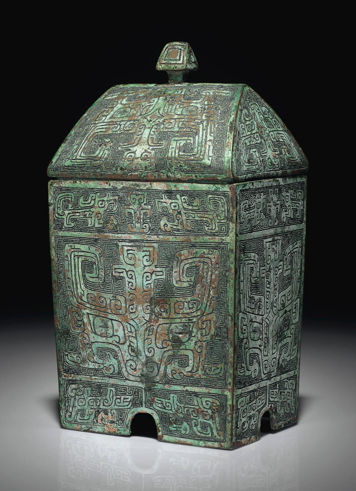 A very rare bronze ritual rectangular wine vessel and cover, Fangyi